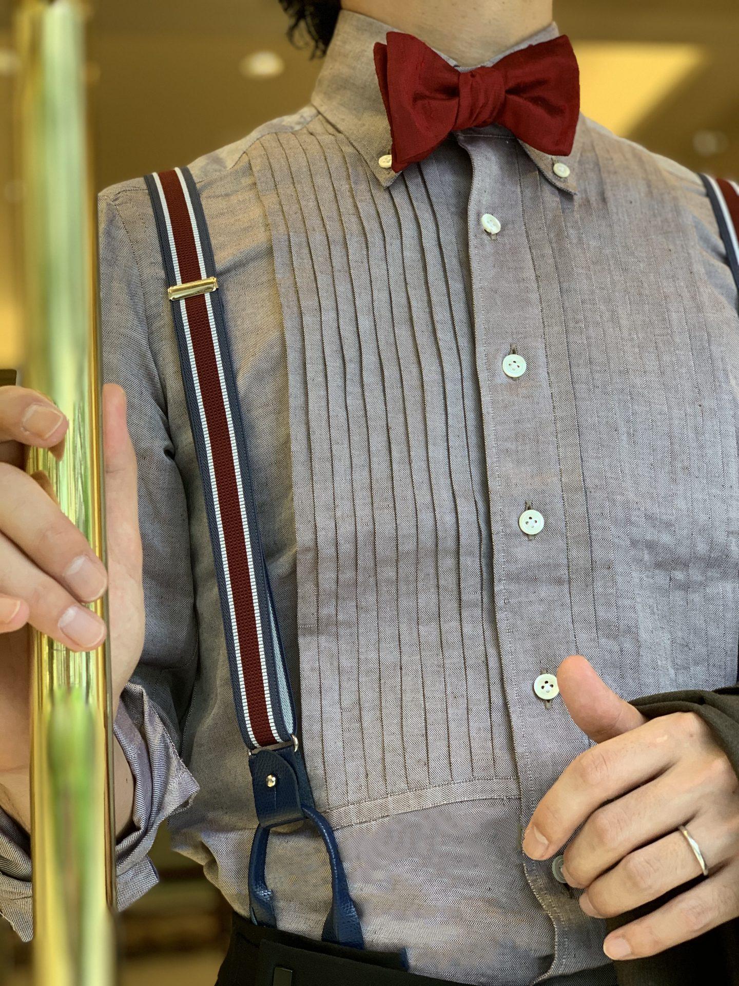 ザ・トリートドレッシング大阪店にあるプリーツシャツやサスペンダーを合わせたファッショナブルなお色直しコーディネート