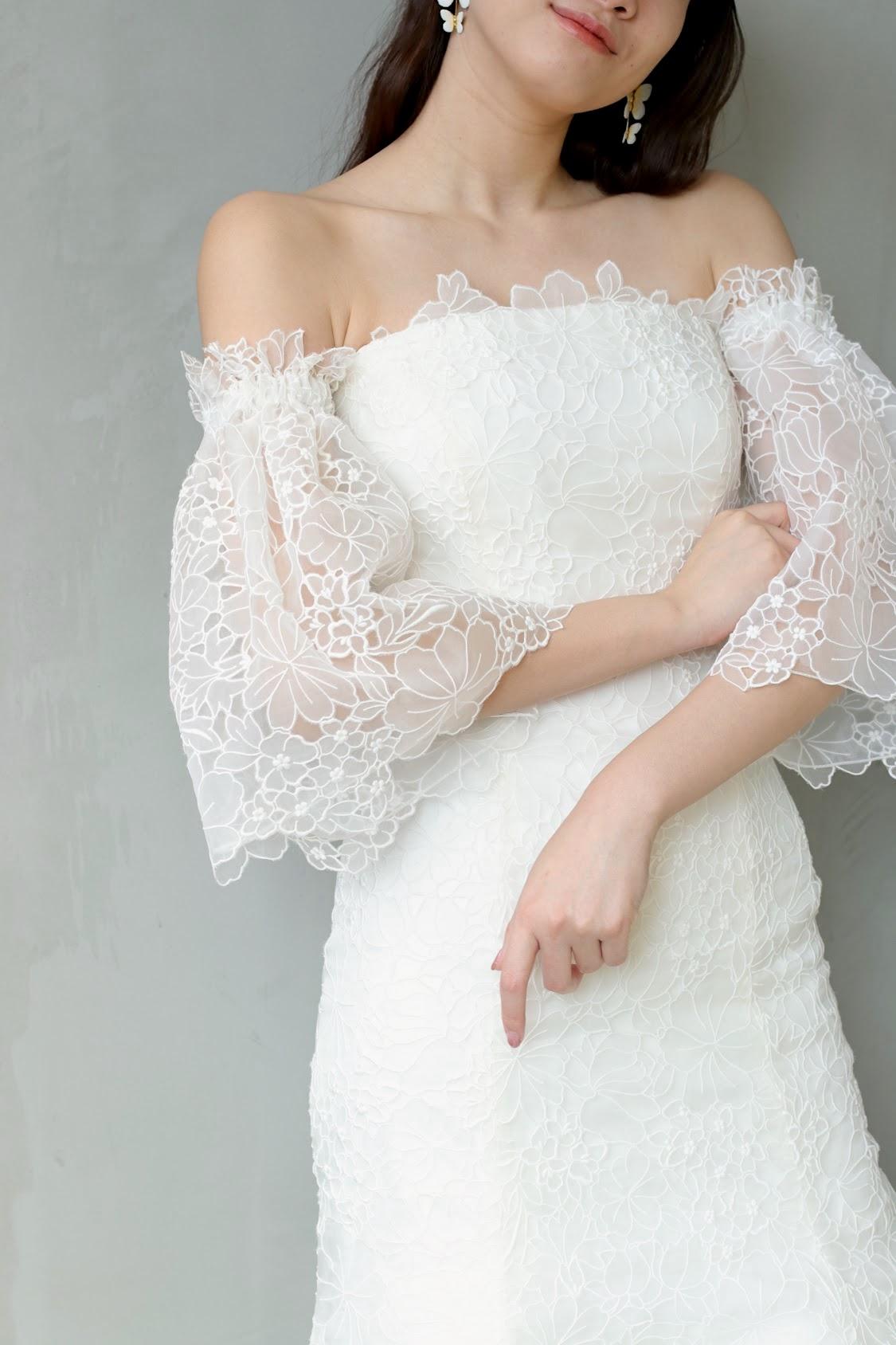 東京で人気のインポートドレスショップ ザ・トリート・ドレッシングの新作ウェディングドレスは、大人っぽいマーメイドラインにガーリーな総レース、そしてトレンドのスリーブデザインでお洒落な花嫁様にオススメしたい1着です