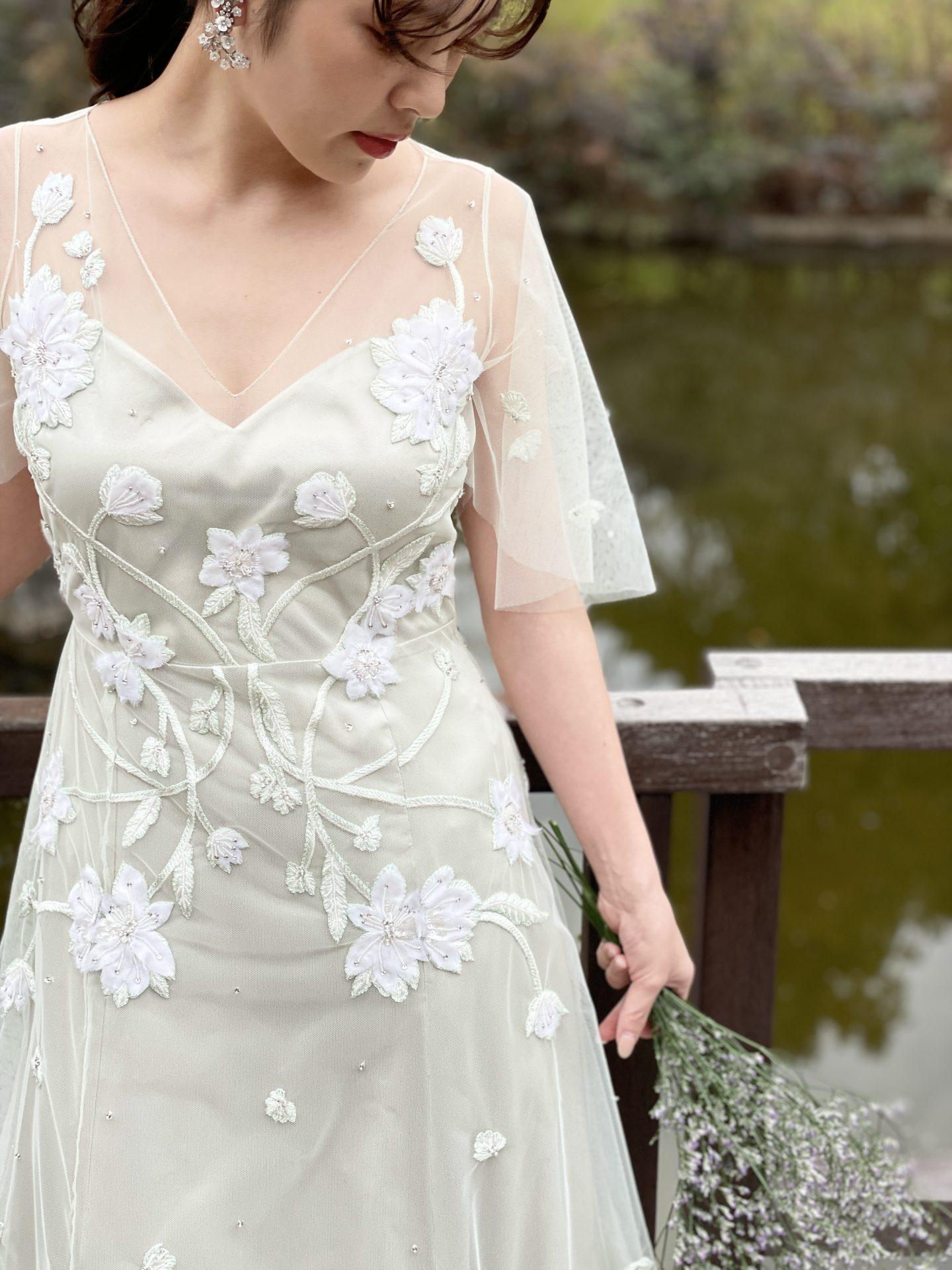 鶴見ノ森迎賓館の提携ドレスショップであるザ・トリートドレッシング大阪店がおすすめするアレクサンドラ・グレッコのグリーンのカラードレス