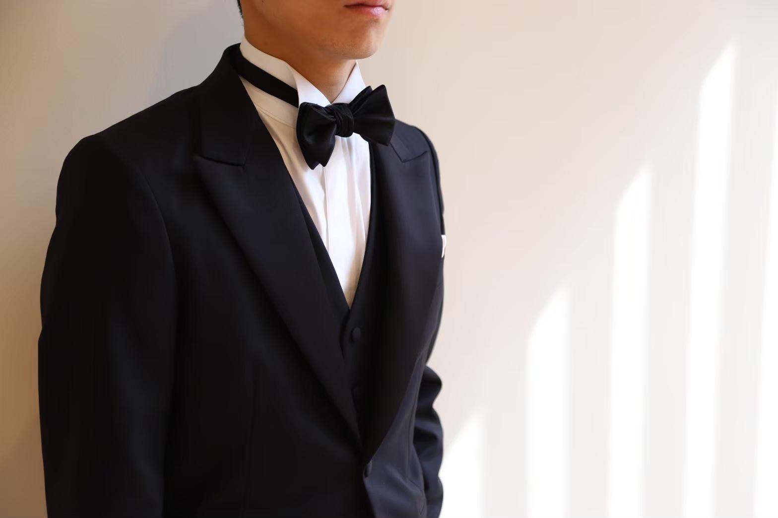 TREAT Gentlemanがお取り扱いするブラックのタキシード。男性らしいさと知性を感じさせます。